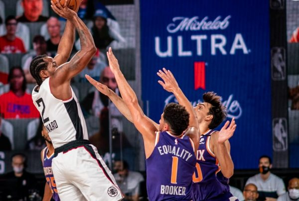 LA Clippers Kawhi Leonard shoots over Phoenix Suns Devin Booker in the NBA's Orlando Bubble